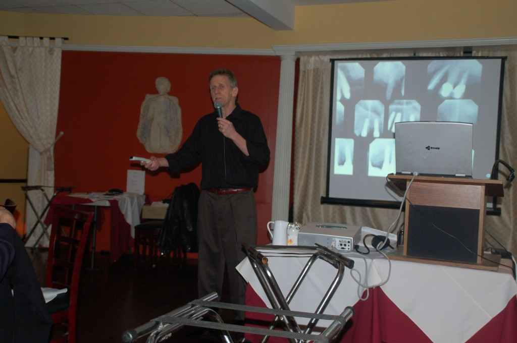 Dr. Fialkoff explaining several x-rays to people in his course