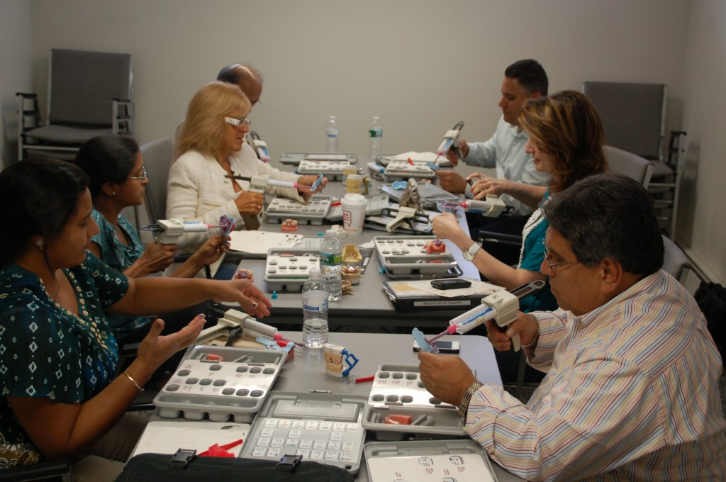 People working on creating implants during one of Dr. Fialkoff's courses
