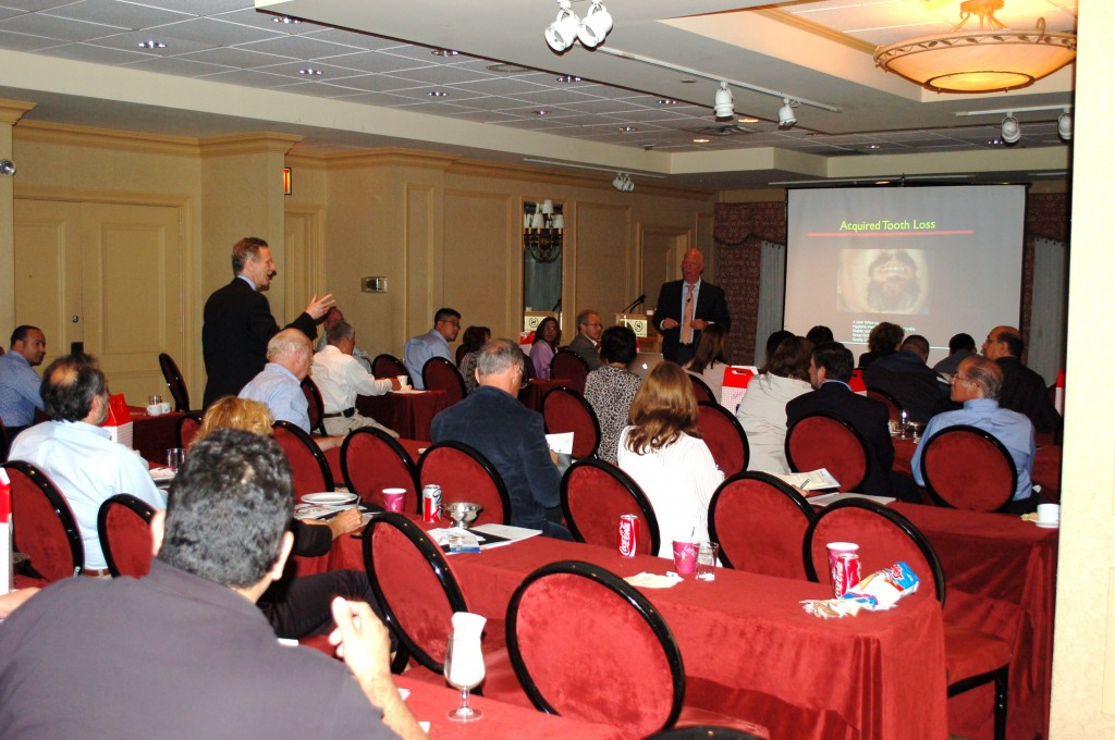 Dr. Fialkoff giving lectures on his Implant Certainty Training program