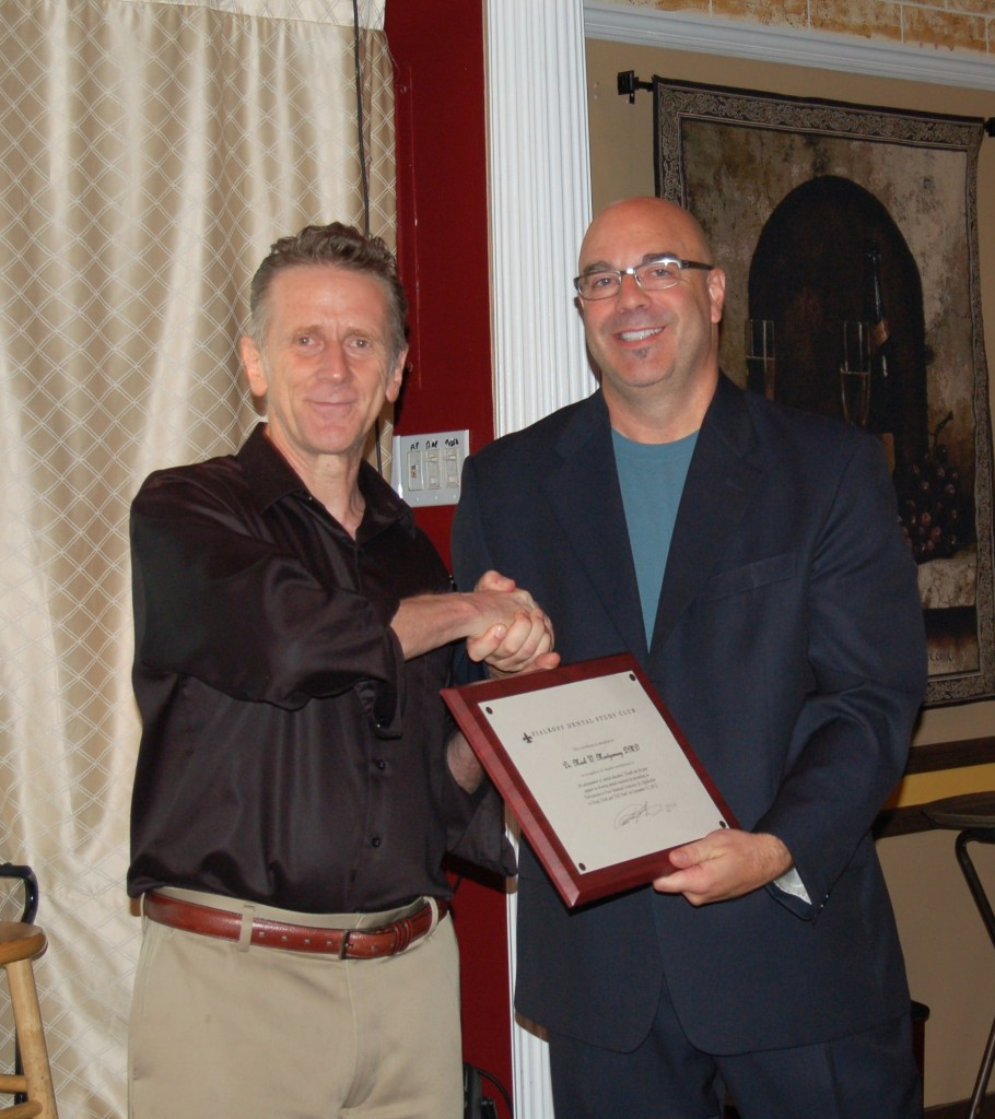 Dr. Mark W. Montgomery DMD receives his award with Dr. Fialkoff